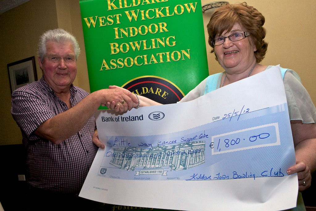 Eamon Hennessy on behalf of Kildare Town Bowling Club presents a cheque for E1,800 to Hilda Boland on behalf of the Little Way Cancer Support  Centre.
